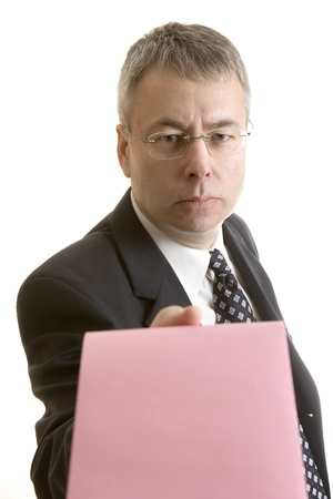 downsized: You`re Fired businessman giving pink slip  Stock Photo