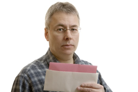 Shocked man reading layoff notice  photo