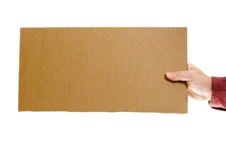 holding blank sign: Casual dressed man`s hand holding a blank cardboard sign