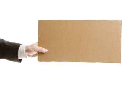hire: Businessman`s hand holding a blank cardboard sign