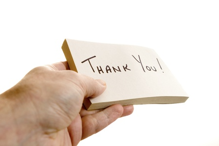 thanking: hand giving a thank you note