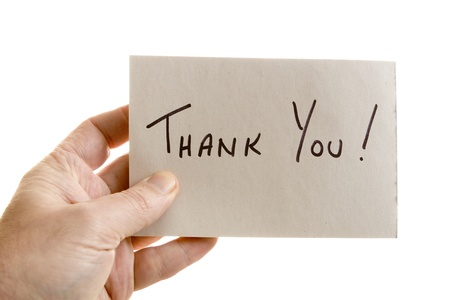 Hand holdins a thank you note