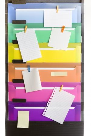 白紙のノートを持つカラフルなファイル フォルダー 写真素材