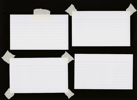 Blank index cards some with masking tape  Stockfoto