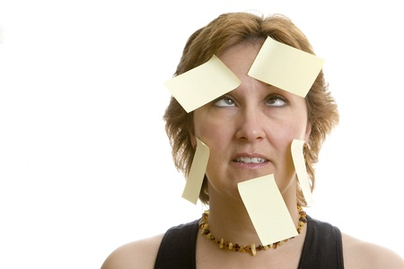 multi tasking: Confused office worker full of adhesive stickies  Stock Photo