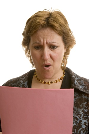 downsized: Businesswoman reading her layoff notice  Stock Photo
