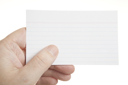 Closeup of hand holding a blank index card  photo