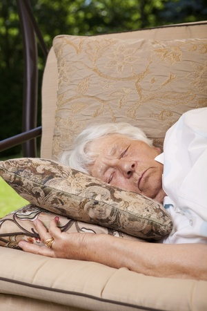 siesta: Senior woman sleeping outside