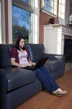 telecommuter: Young woman using laptop