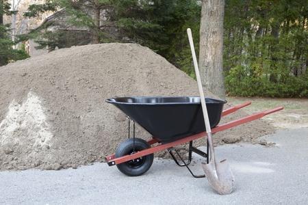 Wheelbarrow shovel and dirt  photo
