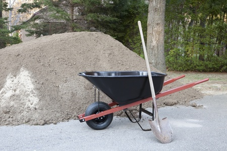 barrow: Wheelbarrow shovel and dirt