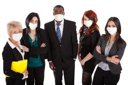 flue season: Equipo de negocios con las m�scaras de la gripe