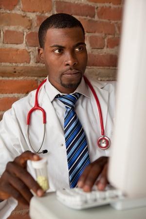 Young doctor prescribing medication  Stok Fotoğraf