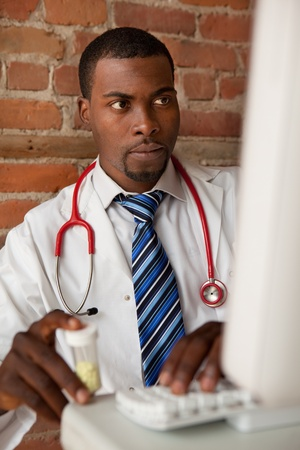 Young doctor prescribing medication  photo