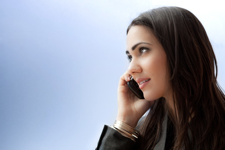 woman on phone: Young businesswoman talking on smartphone