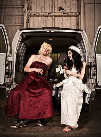 Bride and cross dressing bridesmaid at Hillbilly Wedding