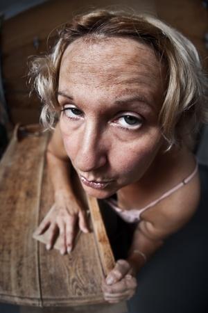 Fedup woman sanding furniture  photo