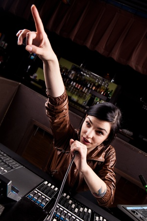 Soundboard technician doing a sound check  photo