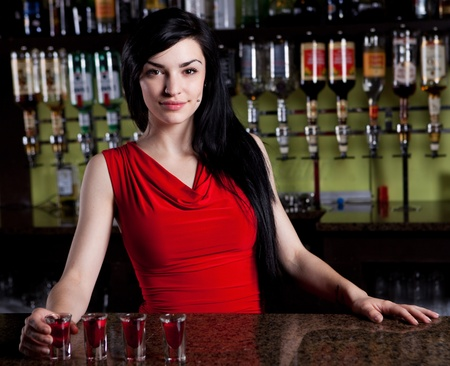 hotel staff: Barmaid in red