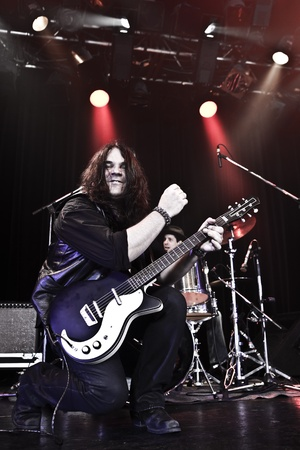 Rock guitarist performing on stage  photo