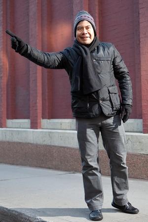 Hispanic man hailing a taxi  Stock Photo