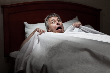 Man startled awake by intruder  Stock Photo - 11814592