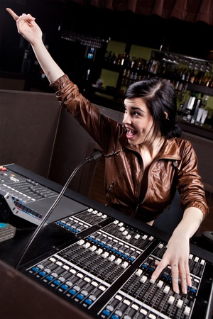 audio mixer: Soundboard technician doing a sound check
