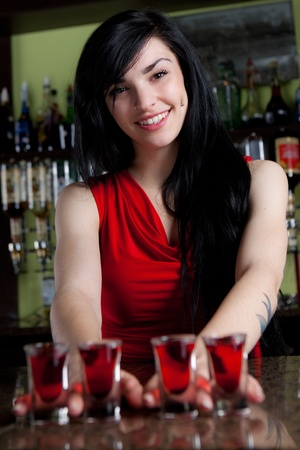 hotel: Barmaid in red