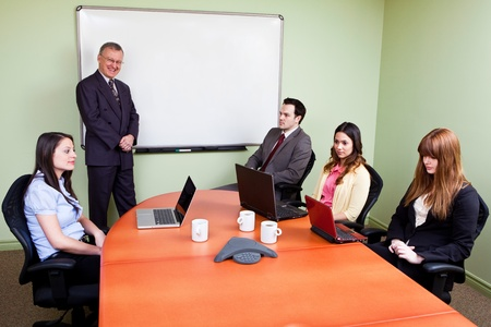 Unmotivated Staff - Boss trying to convince staff to do unethical things  Stock Photo