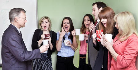 People holding ceramic coffee cups looking in horror at mans eco unfriendly cup  Stock Photo - 12065571