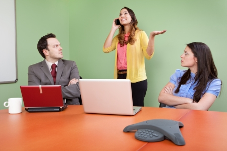 rude: Rude colleague disturbing meeting by talking on Smartphone