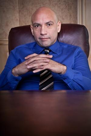 man behind: Serious businessman portrait
