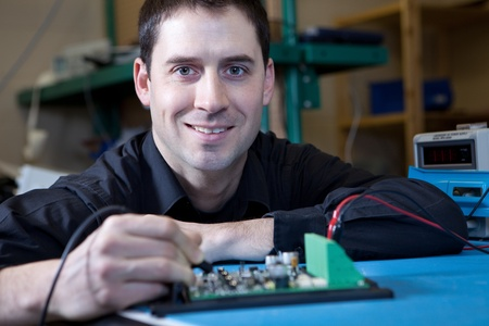 board: Engineer testing a circuit board assembly
