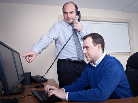 service desk: Boss on the phone with a customer  Stock Photo