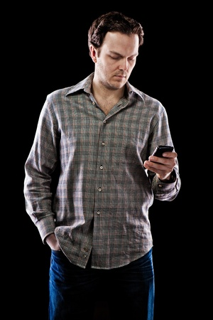 Man texting on smartphone  photo