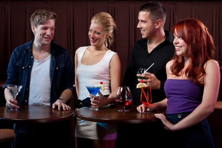 after the party: Friends having fun at a nightclub  Stock Photo