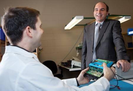 electronic: Engineer and Salesman talking
