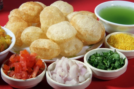 chaat: Close-up of puri and other ingredients of pani puri LANG_EVOIMAGES