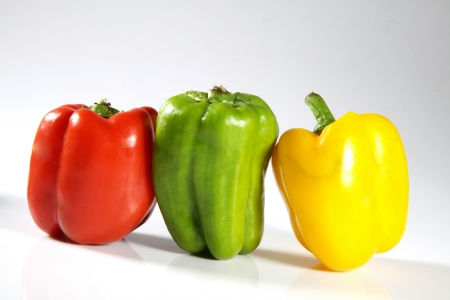 Close-up of bell peppers against white background Stock Photo - 17327326