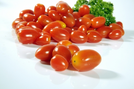 Close-up of tomatoes and coriander leaves Stock Photo - 17327328