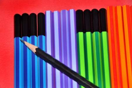 sho:  Close-up of colorful pencils on red background LANG_EVOIMAGES