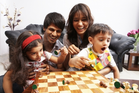 Portrait of a family playing chess Stock Photo - 17327457