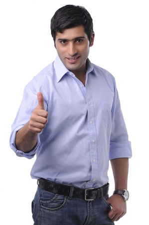 thumbup: Portrait of a young man showing thumbs-up