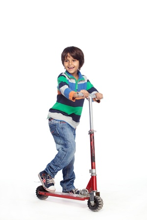 Portrait of  little boy with foot push skate cycle Stock Photo - 17327577