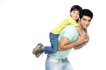 Portrait of  father carrying his son on piggy back Stock Photo - 17327265