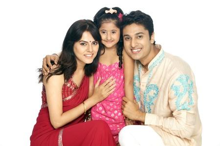 kurta: Parents with daughter smiling