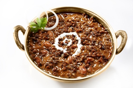 Dal makhani garnished with butter,coriander and onions photo