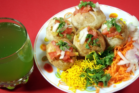 pani: Close-up of pani puri served in a plate