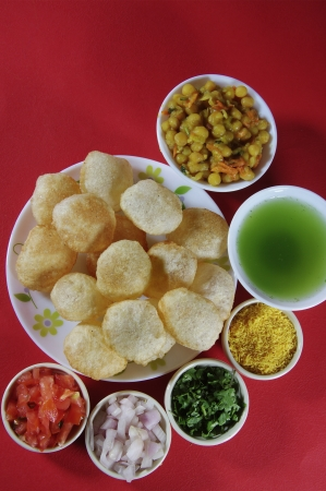 Close-up of puri and other ingredients of pani puri photo