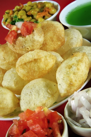 chaat: Close-up of puri and other ingredients of pani puri Stock Photo